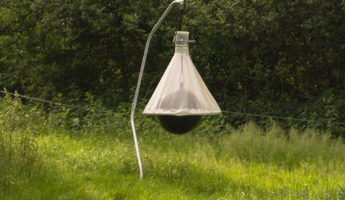 Horse fly trap hanging in a field